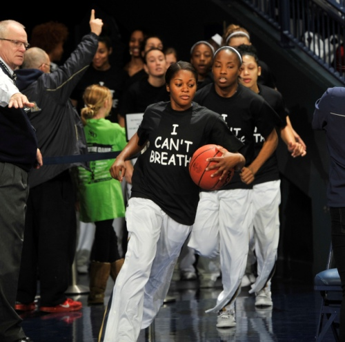 """Notre Dame players wears an """"I Can't Breathe"""" shirts during warm-ups before an NCAA college basketball game against Michigan,  Saturday, Dec. 13, 2014 in South Bend, Ind.  (AP Photo/Joe Raymond)"""